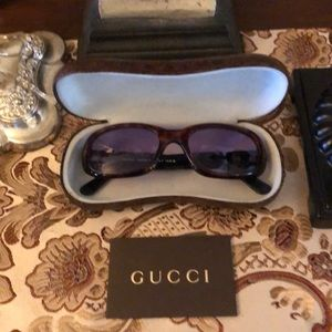Gucci sunglasses with case and authenticity card.
